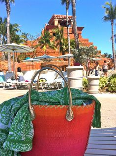 My #Goodwill beach bag ($5.99) relaxing by the pool in the #Bahamas. #beach #pool #thrift #vacation