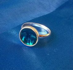 Check out this item in my Etsy shop https://www.etsy.com/uk/listing/520251296/ethereal-man-in-the-moon-ring-blue