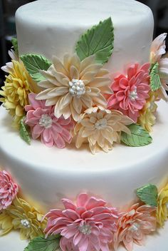 Beautiful dahlia covered tiered wedding cake. #food #wedding #cakes #flowers
