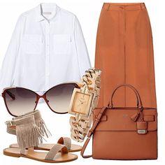 Abbinamento rigoroso e androgino per questo outfit, Pantaculotte arancio bruciato abbinati alla camicia bianca dal taglio maschile. Borsa e orologio classy, occhiali e sandali per spezzare con un tocco glamour.