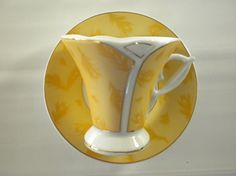 Two Demitasse Gold and White Teacup and Saucer by oldandnew8, $22.00