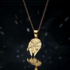 This gold tone Millennium Falcon pendant is an ideal way to show some love for the fastest ship in the galaxy - and an easy way to wear that Star Wars pride. You can pick one up from Star Wars Jewelry, Lando Calrissian, Millennium Falcon, Chewbacca, Starwars, Pride, Gold Necklace, Star Wars