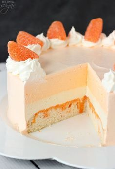 Orange Creamsicle Ice Cream Cake - Vanilla cake soaked with orange flavoring, with layers of vanilla and orange ice cream! Such a fun twist on the classic popsicle! 13 Desserts, Frozen Desserts, Delicious Desserts, Dessert Recipes, Frozen Treats, Summer Desserts, Icecream Cake Recipes, Unique Desserts, Dessert Bars