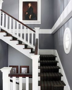 Like the bold white horizontal stipe.  England style home staircase ideas