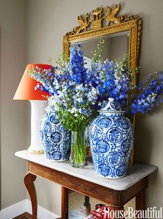 Sam Allen gave the tiny entry pizzazz by using large-scale pieces, like a pair of ginger jars, a vintage mirror, and a Christopher Spitzmiller lamp. Walls in Farrow & Ball's Light Gray.