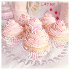 vanilla cupcakes with a strawberry jam centre and fluffy pink frosting www.lovecatherine.co.uk www.instagram.com/catherine.mw