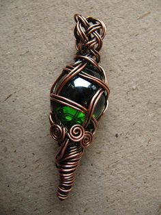 """""""Genie in a Bottle"""" reversible glass pendant & necklace OOAK design. Copper wire wrapped and woven green glass pendulum pendant. The wire has been oxidized for antique look, polished to high shine and sealed with a clear glaze. Comes with a 75cm (30) long snake chain necklace. Pendant"""