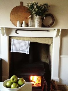 wood burning stoce to keep the kitchen cosy #natrualcurtaincompany