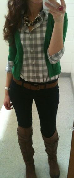Digging this look. Combines a lot of things I like on a woman. Gingham, chunky necklace, boots over jeans.