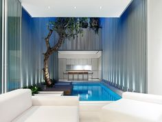 An indoor pool set the stage for this high-end entertaining space complete with seating and a bar.
