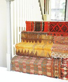 stairs layered in old kilims! such an awesome idea!!! I am not sure weather i want to do this, or keep with the stair/bookshelf idea.