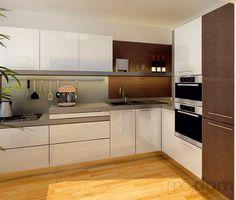 Zámerom pri návrhu kuchynskej linky bolo čo najlepšie využiť daný priestor. Schod pracovnej dosky, ktorý vznikol ako dôsledok položenia novej podlahy, návrhári vtipne využili na príborovú zásuvku.