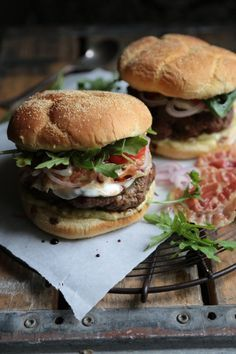 Enjoy all the flavors of Italy in this epic Tuscano Burger - packed with fresh shallots, crisp pancetta, arugula, pesto aioli, and drizzled with balsamic vinegar! Hamburger Recipes, Dog Recipes, Grilling Recipes, Beef Recipes, Burger Night, Big Burgers, Burger Dogs, Tacos And Burritos, Homemade Hamburgers
