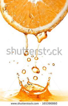 Orange Slice Splash Juice Isolated On: стоковая фотография (редактировать), 165396860