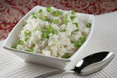 easy coconut rice by recipe girl  Yield: Serves 6  Prep Time: 10 min Cook Time: 20 min  Ingredients:  One 13.66-ounce can light coconut milk  1 1/4 cups water  1 1/2 cups white rice  1/4 cup chopped green onions  toasted coconut, optional    Directions:  1. In a medium saucepan, bring coconut milk and water to a boil. Stir in the rice and cover the pan. Reduce heat to a simmer and cook for 20 to 25 minutes, or until the rice has absorbed the liquid and is light and fluffy.