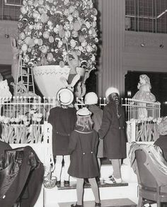 CHICAGO – MARSHALL FIELD DEPARTMENT STORE – WALNUT ROOM RESTAURANT – GIRLS BY TREE – 1962. My Aunt took me here as a child and we ate snowman sundae.
