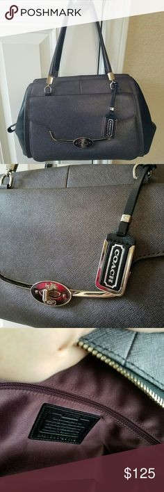 Coach purse Auth Coach pewter and black color. This executive bag  will compliment your suit or business attire. Inside is a Burgundy satin fabric with a zippered compartment and 2 pockets. Very roomy, it open wide for easy access. In very good condition. Coach Bags Satchels