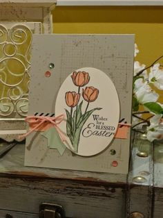 Stampin' Up! ... hand crafted Easter card f ... kraft base with grungy sptamping ... tulips and and Easter blessing ... washi tape, sequins and thick melon twine ... like it!