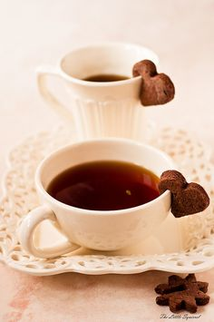 tea and chocolate cookies - I like all these little bite-sized biscuits on the edge of tea and coffee cups.