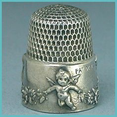 Antique Child's Cupid Sterling Silver Thimble by Simons Bros * 1905 Patent. ( have 2 of these. $10.00 for one and $3.50 for the other)