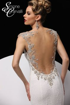 Simone Carvalli wedding gown - lace trumpet silhouette gown with beaded sweetheart neckline and beaded plunging illusion back.