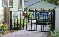 Automatic driveway gates are now being installed in homes of all sizes and price ranges. Find out their benefits, how to install and what gate to buy. Aluminum Driveway Gates, Metal Fence Gates, Driveway Fence, Front Yard Fence, Backyard Fences, Fencing, Privacy Fences, House Front Gate, Front Gates