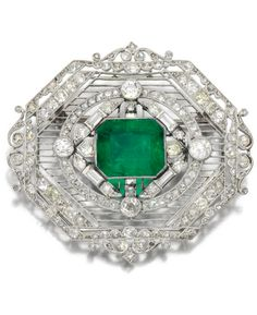 A Belle Epoque emerald and diamond brooch, 1910s. Designed as an octagonal…