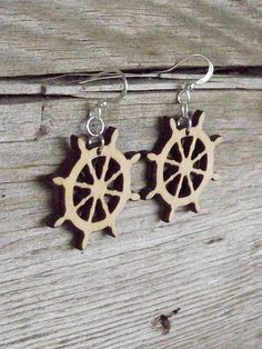 """Wood ship Wheel earrings made from wood.  * Dimension: diameter 3cm / 1.2"""", thickness 3mm / 0.11"""". * Materials: wood, silver plated hooks. * It will come nicely gift wrapped."""