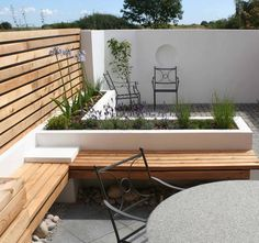 Click on any of the images below to see a slideshow of this small contemporary garden design.