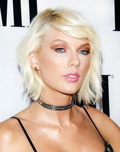 Dealing with a short layer in the front, or growing out bangs? Try the severe side sweep like Taylor.