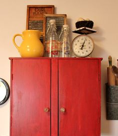 Adding a red cabinet to the wall over the World Market kitchen cart for vertical storage. Red Cabinets, Flea Market Decorating, Vertical Storage, World Market, Kitchen Cart, Kitchens, Cozy, Change, Wall