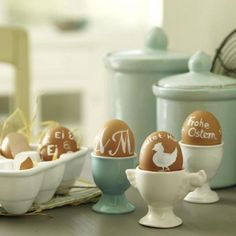 hard-boiled natural brown eggs with white painted designs...almost looks like burlap
