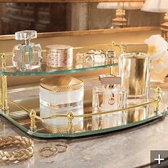 Belmont Two-tier Vanity Tray. I'm experimenting with these vignettes in my reach-in closet and bathroom countertop. This can be replicated easily; it need not be expensive and if possible, you can recycle used bottles & jars.
