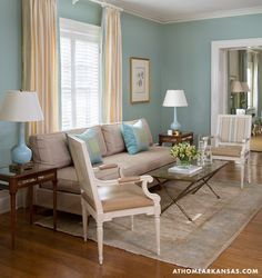 Creating a Legacy | At Home Arkansas | Design by @MH Design Inc | Photography by @Nancy Nolan Photography #TriDelta #UniversityofArkansas A separate sitting area offers a more formal setting for welcoming guests.