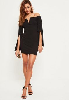 Add a little bit of quirkiness to the party season and feast your eyes over this mini dress - featuring split flared sleeves for a boho vibe, a jet black hue and bardot style.