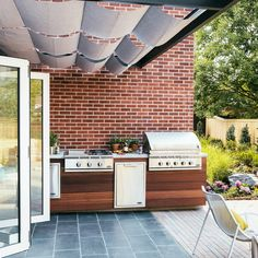 Open up - Smart Ideas from a Stunning Mid-Century Modern Remodel - Sunset | awning + outdoor kitchen