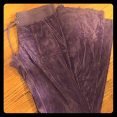 Purple Velour Juicy Couture Pants These juicy couture pants are the perfect lounge wear addition to your wardrobe. So comfortable and so flattering! Juicy Couture Pants Track Pants & Joggers