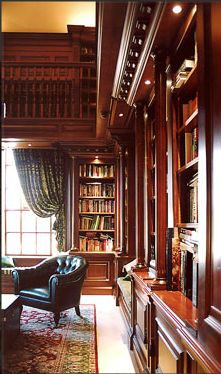 Double-height columned library in polished cherry. www.martinoakley.co.uk