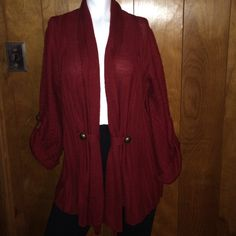 This is a beautiful sweater/cardigan. Mint condition. The color is burgundy very nice dressed with boots. Open to offers Sweaters