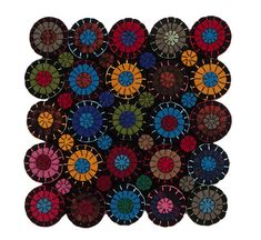 Recycled felted wool penny rug 10 x 10 multi-colored and black Most wool is re-purposed, washed and felted, most are coats, jackets, and suit coats. Penny rugs date back to the mid 1800s and were created either as floor mats, for warmth on a bed or as decoration. Scraps of wool from old