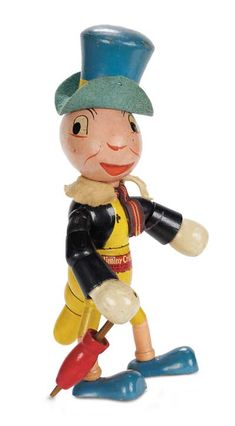 JIMINY CRICKET ~ by: Ideal, all wooden character depicting the character from Disney's Pinocchio film of 1940, swivel head,  NARJSl Hunubt Cricket, Des., by Walt Disney, Ideal Novelty & Toy Co, c. 1940.