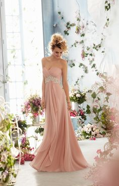 Mori Lee Voyage 6766 is another of the lovely dresses by Mori Lee that are available in Blush.  If you can pull this color off, it is definitely worth the chance of wearing it!  How beautiful is the chiffon flowing piece in the front that is joined to the dress at the beaded waist