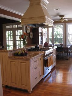 island with a raised area to hide the stove.