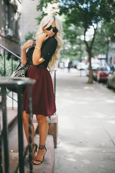Top fashion 2014. Get with the style with this black T-shirt and red skirt.