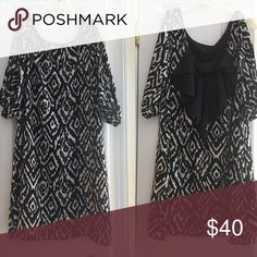 Tribal cold shoulder boutique shift dress Bow on the back! Super pretty and stylish! No size but can fit between a medium and large. Length is 34 inches Dresses Mini