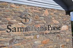 dark oxidized bronze letters and logo installed to rough stone wall by impactsigns.com, via Flickr