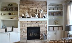 Love the stone fireplace with the white built-ins.  Similar layout as ours but with brick.