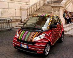 Yarn bombing (or yarnbombing, yarnstorming, guerrilla knitting, urban knitting or graffiti knitting) is a type of graffiti or street art that employs colorful Art Au Crochet, Crochet Car, Crochet Amigurumi, Crochet Blogs, Funny Crochet, Crochet Things, Smart Auto, Smart Car, Yarn Bombing