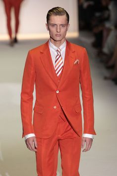 Gucci: Runway - Milan Fashion Week Menswear Spring/Summer 2013    Orange Men's Suit with striped tie.