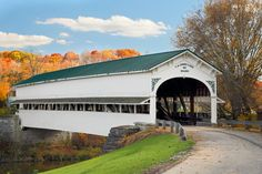 The historic Westport Covered Bridge crosses Sand Creek in rural Decatur County, Indiana backed by colorful autumn foliage. Photo by Kenneth Keifer. Click the photo to see more of Ken's photography.